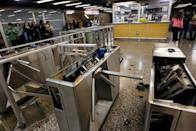 The subway ticket gates are seen destroyed after protests against the increase in the subway ticket prices in Santiago