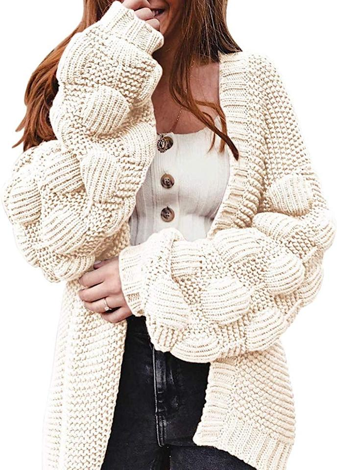 "<p>This cute <a href=""https://www.popsugar.com/buy/Ferbia-Long-Cardigan-Sweater-500912?p_name=Ferbia%20Long%20Cardigan%20Sweater&retailer=amazon.com&pid=500912&price=33&evar1=fab%3Aus&evar9=46895215&evar98=https%3A%2F%2Fwww.popsugar.com%2Ffashion%2Fphoto-gallery%2F46895215%2Fimage%2F46895253%2FFerbia-Long-Cardigan-Sweater&list1=shopping%2Camazon%2Csweaters%2Cwinter%20fashion&prop13=mobile&pdata=1"" rel=""nofollow"" data-shoppable-link=""1"" target=""_blank"" class=""ga-track"" data-ga-category=""Related"" data-ga-label=""https://www.amazon.com/dp/B07T49KFLR/ref=tsm_1_ig_s_fshn_clopomsweater100719?utm_campaign=likeshopme&amp;utm_medium=instagram&amp;utm_source=dash%20hudson&amp;utm_content=www.instagram.com/p/B3VVnerBQZ_/"" data-ga-action=""In-Line Links"">Ferbia Long Cardigan Sweater</a> ($33) is a great layering piece.</p>"