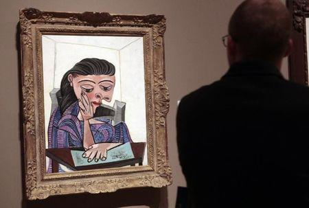 A visitor stops to look at a painting by Picasso at the Detroit Institute of Arts in Detroit