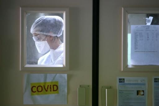 A nurse works in the COVID-19 area of the Eugenie Hospital in Ajaccio, on the French Mediterranean island of Corsica