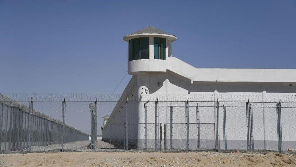 This photo taken on May 31, 2019 shows a watchtower on a high-security facility near what is believed to be a re-education camp where mostly Muslim ethnic minorities are detained, on the outskirts of Hotan, in China's north-western Xinjiang region.