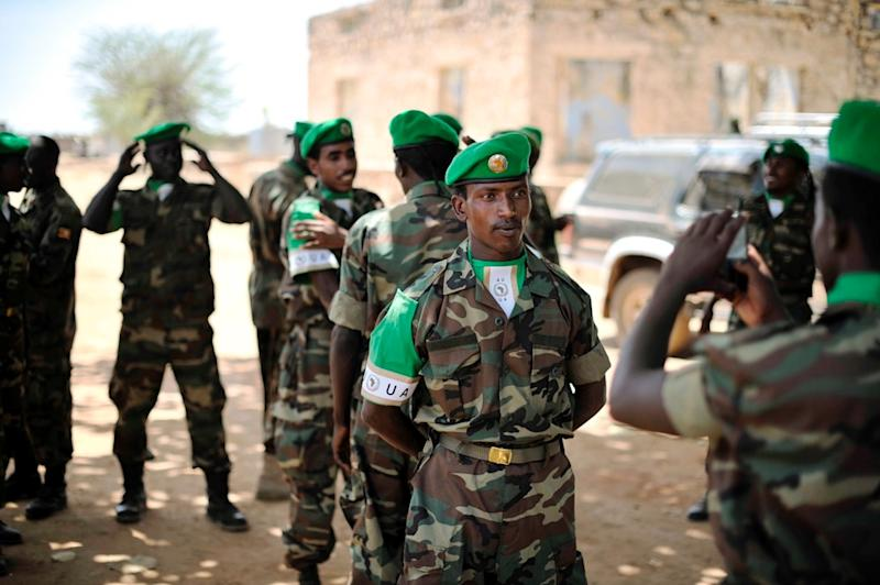 An Ethiopian soldier has his photo taken wearing an African Union beret after a ceremony in Baidoa, Somalia on January 22, 2014 (AFP Photo/)
