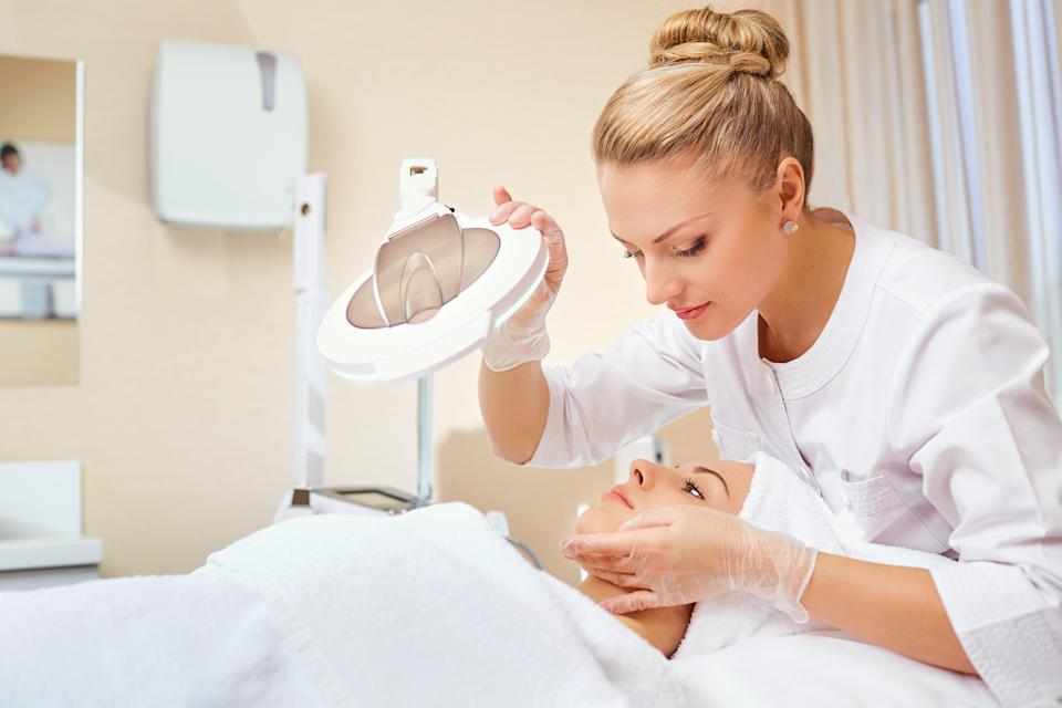 Cosmetologist is a professional with a patient in the office of a medical clinic.
