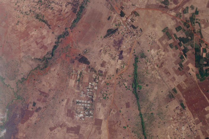 FILE - In this file satellite photo dated April 22, 2021 provided by Planet Labs shows an agricultural college where witnesses say ethnic Tigrayans have been detained for months without charge, one of several such detention centers across the country. Some thousands of Eritrean refugees are among the most vulnerable groups in the conflict and are increasingly caught in the middle of the conflict in Ethiopia's Tigray region. (Planet Labs, FILE via AP)