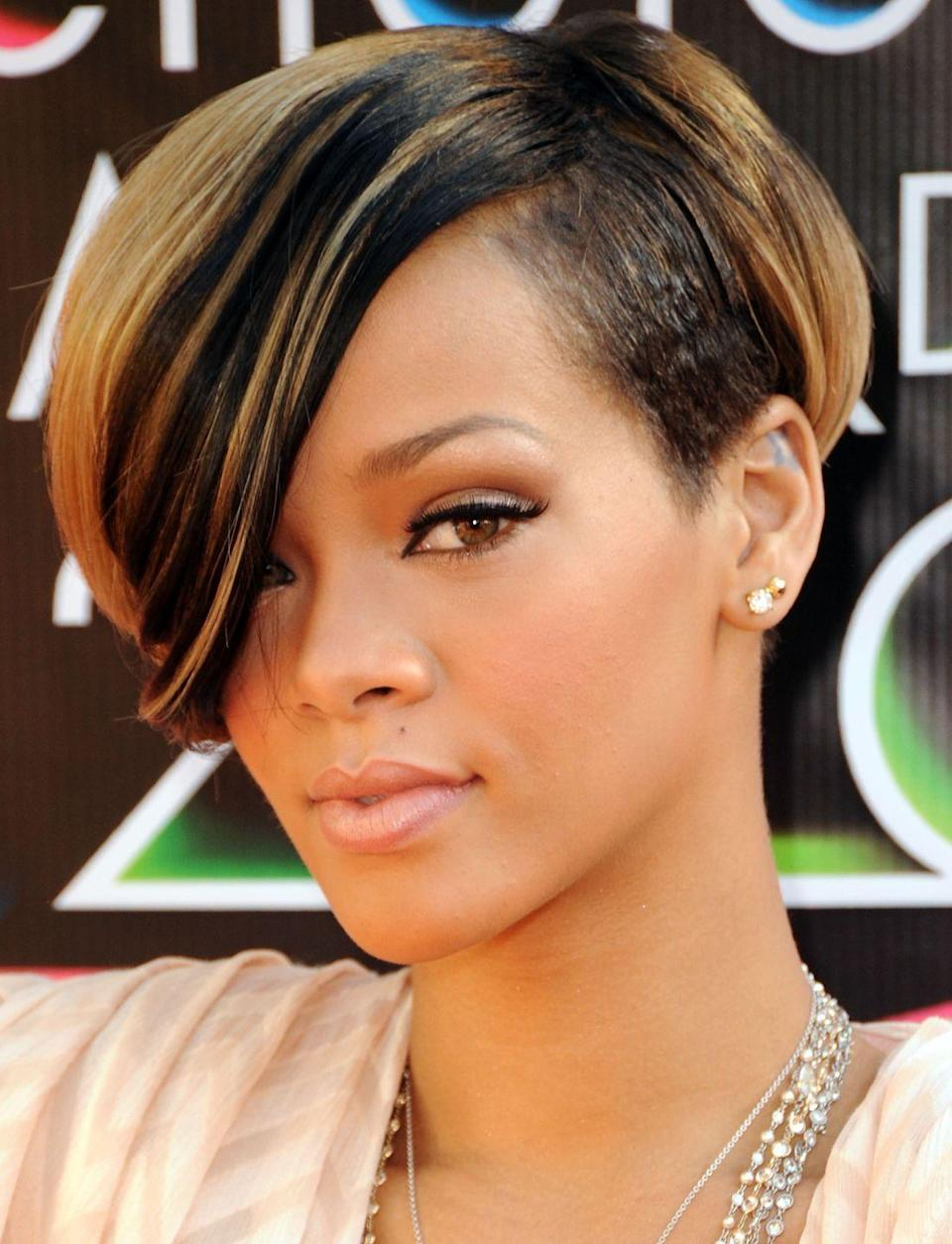 <p>What's more to love about singer <strong>Rihanna's </strong>throwback style, the color or the cut? Not to mention, the deep side part and major swoop gives this look sexy yet sweet vibes. </p>