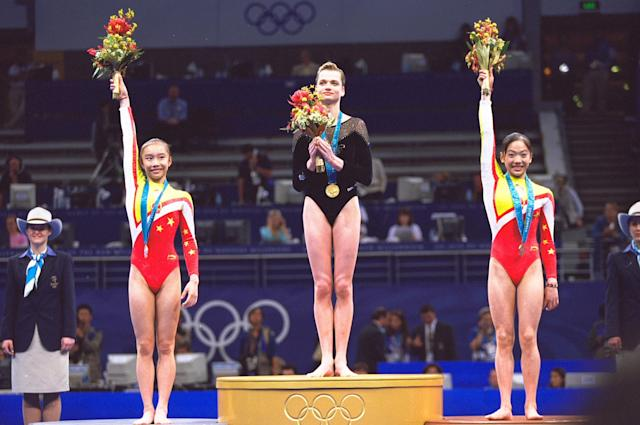24 Sep 2000: Svetlana Khorkina of Russia (centre) wins Gold, Jie Ling of China (left) wins Silver and Yun Yang of China (right) wins Bronze in the Uneven Bars Final at the Sydney Superdome on Day Nine of the Sydney 2000 Olympic Games in Sydney, Australia. \ Mandatory Credit: Jed Jacobsohn /Allsport