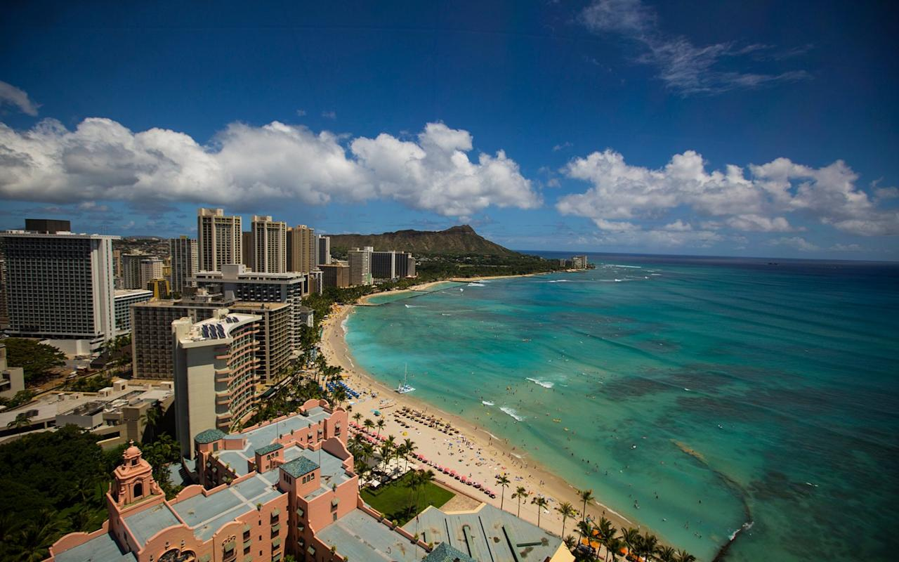 """<p>Travelers have been flocking to this calm, golden, crescent-shaped stretch of sand on <a href=""""http://www.travelandleisure.com/articles/oahu-hawaii-travel"""" target=""""_blank"""">the island of Oahu</a> since the early 1900s—when Hawaii first popped up on the tourist radar, and visitors would arrive only by steamship. Today, it's a bit more crowded, but the scene is still fun: grab a mai tai at the iconic Royal Hawaiian hotel, built in 1927; kick back; and watch locals mingle with tourists, all with impressive Diamond Head as a backdrop.</p>"""