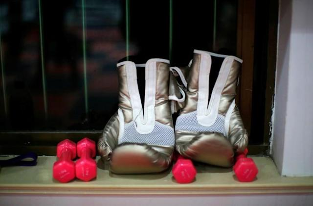 FILE PHOTO: Boxing gloves are seen by a window at Princess Women's Boxing Club in Shanghai