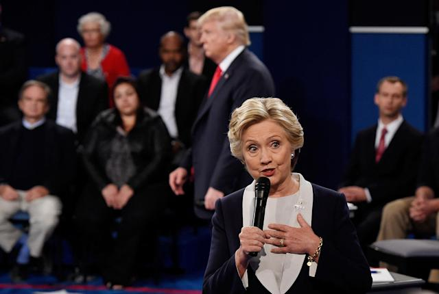 <p>Democratic presidential nominee former Secretary of State Hillary Clinton speaks as Republican presidential nominee Donald Trump listens during the town hall debate at Washington University on Oct. 9, 2016 in St Louis, Mo. (Photo: Saul Loeb-Pool/Getty Images) </p>