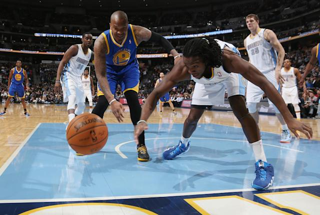 Golden State Warriors center Marreese Speights, left, pursues a loose ball with Denver Nuggets forward Kenneth Faried during the first quarter of an NBA basketball game in Denver on Wednesday, April 16, 2014. (AP Photo/David Zalubowski)