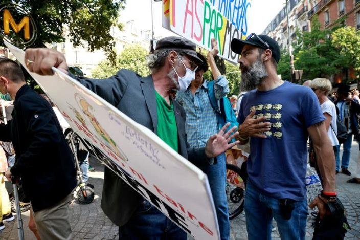 """FILE PHOTO: Jerome Rodrigues talks with a demonstrator during a """"yellow vests"""" protest"""