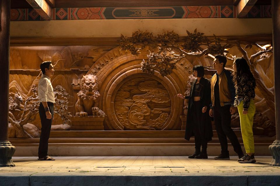 """Wenwu (Tony Leung, left) confronts daughter Xialing (Meng'er Zhang), son Shang-Chi (Simu Liu) and Shang-Chi's pal Katy (Awkwafina) in """"Shang-Chi and the Legend of the Ten Rings."""""""