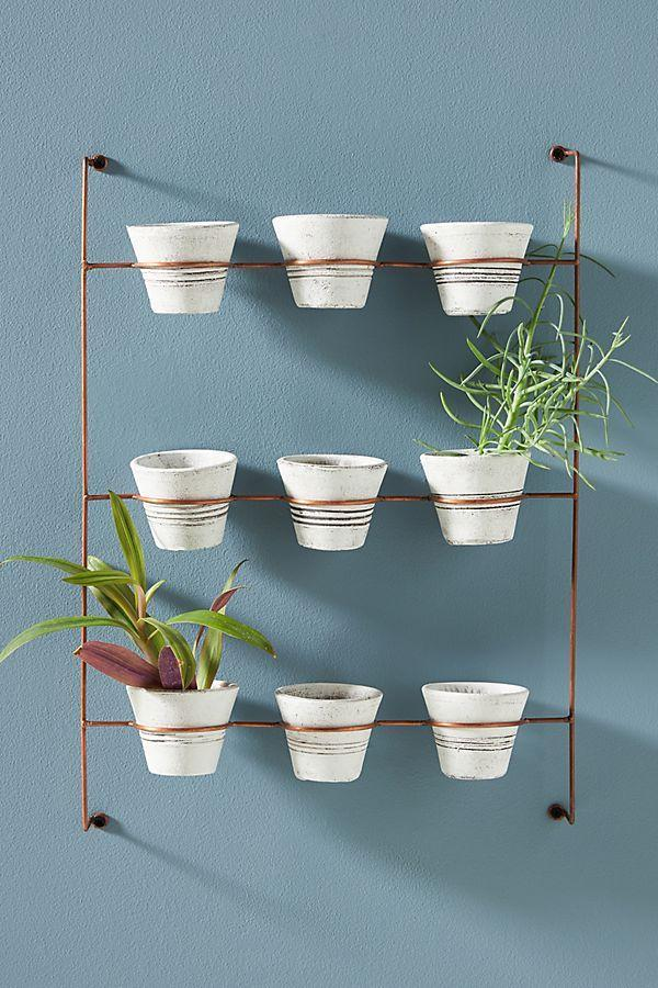 """<h3>Viva Terra Hanging Clay Pots</h3><br>Why settle for one planter bowl when you can have nine? This hanging-clay-pot unit is making our living-wall dreams an under $100 reality.<br><br><strong>Viva Terra</strong> Hanging Clay Pots, Set of 9, $, available at <a href=""""https://go.skimresources.com/?id=30283X879131&url=https%3A%2F%2Fwww.vivaterra.com%2Fp%2FV4555"""" rel=""""nofollow noopener"""" target=""""_blank"""" data-ylk=""""slk:Viva Terra"""" class=""""link rapid-noclick-resp"""">Viva Terra</a>"""