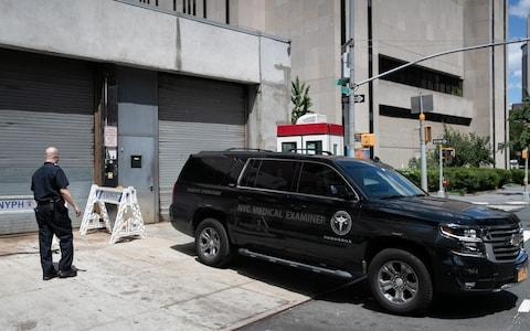 A medical examiner car is seen outside New York Presbyterian-Lower Manhattan Hospital,  - Credit: Reuters