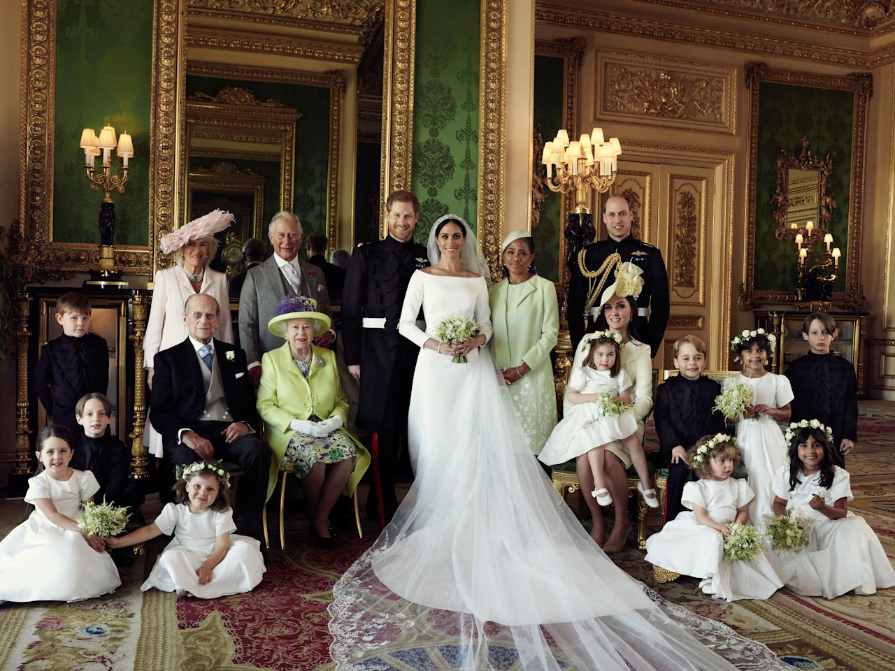 <p>This official wedding photograph released by the Duke and Duchess of Sussex shows The Duke and Duchess in The Green Drawing Room, Windsor Castle, with (left-to-right): Back row: Master Jasper Dyer, the Duchess of Cornwall, the Prince of Wales, Ms. Doria Ragland, The Duke of Cambridge; middle row: Master Brian Mulroney, the Duke of Edinburgh, Queen Elizabeth II, the Duchess of Cambridge, Princess Charlotte, Prince George, Miss Rylan Litt, Master John Mulroney; Front row: Miss Ivy Mulroney, Miss Florence van Cutsem, Miss Zalie Warren, Miss Remi Litt. (PA) </p>