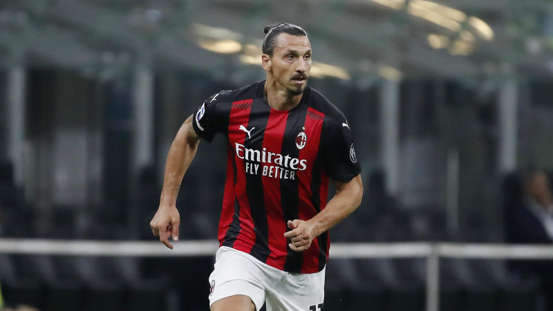 Zlatan Ibrahimovic in a red and black AC Milan kit.