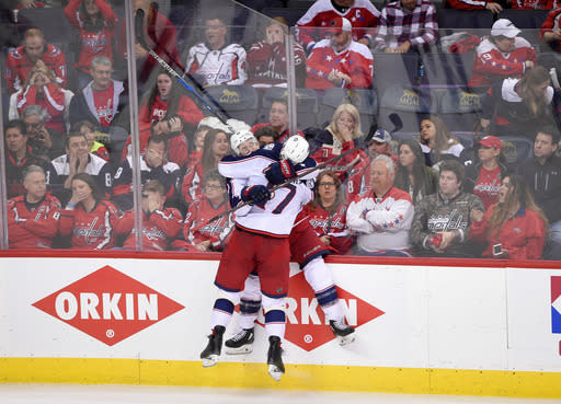 CORRECTS FINAL SCORE TO 5-4 IN OVERTIME, INSTEAD OF 4-3 IN OVERTIME - Columbus Blue Jackets left wing Matt Calvert (11) celebrates his game-winning goal with center Brandon Dubinsky (17) in overtime in Game 2 of an NHL first-round hockey playoff series against the Washington Capitals, Sunday, April 15, 2018, in Washington. The Blue Jackets won 5-4 in overtime. (AP Photo/Nick Wass)