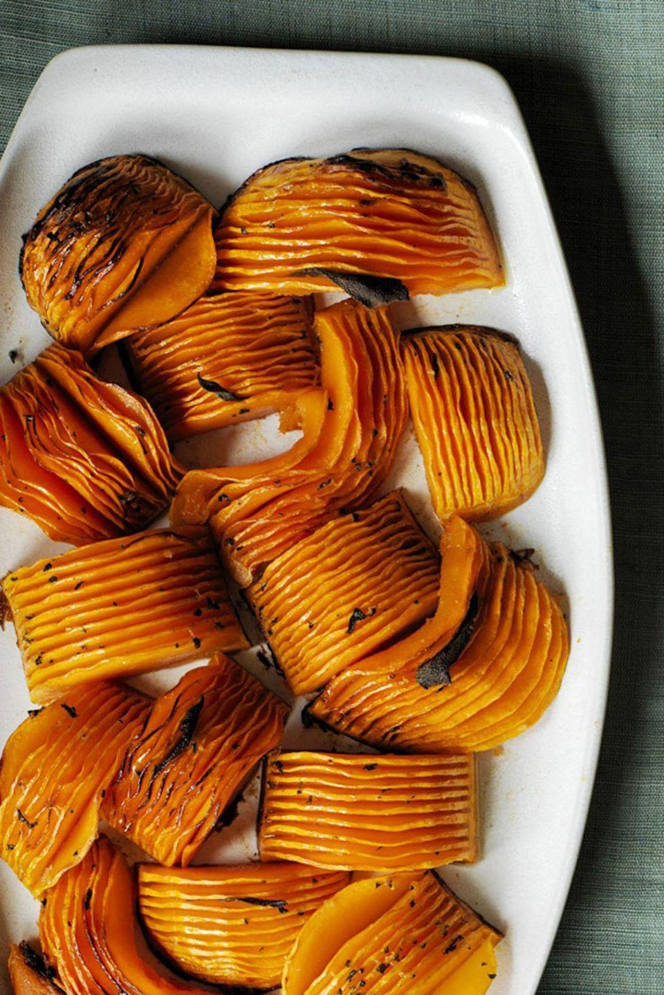 """<p>These seasoned, buttery sweet potatoes will be the talk of the night and make a perfect fall appetizer. </p><p><strong><em><a href=""""https://www.womansday.com/food-recipes/food-drinks/recipes/a60499/hasselback-butternut-squash-with-browned-butter-recipe/"""" rel=""""nofollow noopener"""" target=""""_blank"""" data-ylk=""""slk:Get the recipe for Hasselback Butternut Squash with Browned Butter."""" class=""""link rapid-noclick-resp"""">Get the recipe for Hasselback Butternut Squash with Browned Butter.</a></em></strong></p>"""