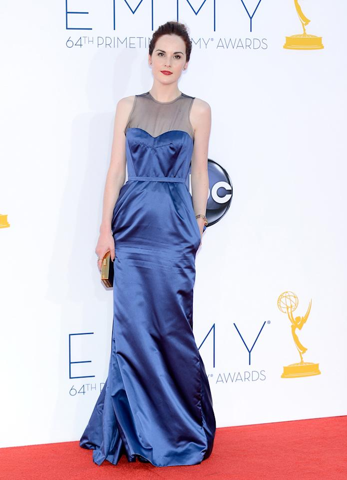 Michelle Dockery arrives at the 64th Primetime Emmy Awards at the Nokia Theatre in Los Angeles on September 23, 2012.