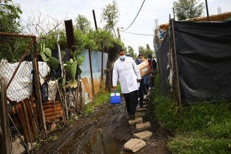 Mexico, nearing 500,000 coronavirus cases, to help with vaccine