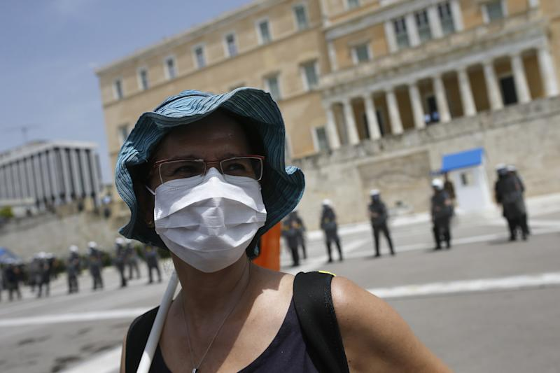 ATHENS, GREECE - MAY 19: A woman wearing a face mask is seen in front of the parliament building during a protest by teachers and students against the reforms in the education system as part of the novel coronavirus (COVID-19) pandemic measures in Athens, Greece on May 19, 2020. (Photo by Ayhan Mehmet/Anadolu Agency via Getty Images)