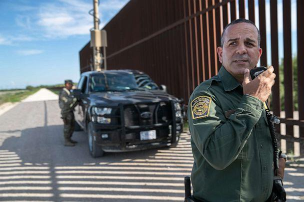 PHOTO: U.S. Border Patrol agent Carlos Ruiz spots a pair of undocumented immigrants while coordinating with active duty U.S. Army soldiers near the U.S.-Mexico border fence on Sept. 10, 2019 in Penitas, Texas. (John Moore/Getty Images, FILE)