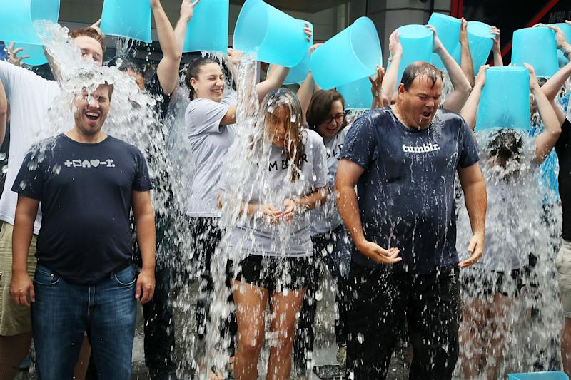 Tumblr executives accept the ALS Ice Bucket Challenge during the ringing of the opening bell at the NASDAQ MarketSite on August 21, 2014 in New York City