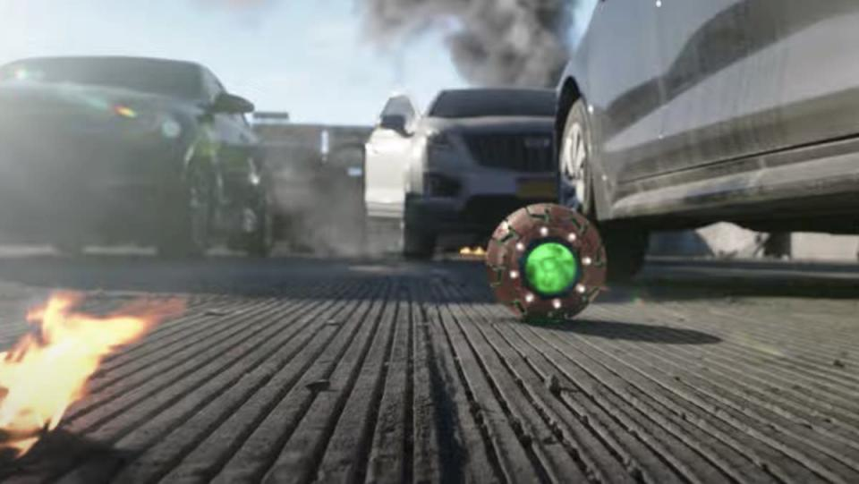 A glowing green round ball near cars on a road
