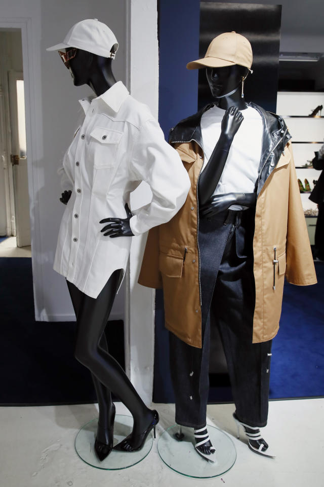"""Creation are displayed as Singer Rihanna, the first black woman in history to head up a major Parisian luxury house, unveiled her first fashion designs for Fenty at a pop-up store in Paris, France, Wednesday, May 22, 2019. Fenty says the brand will be based in Paris, like its parent company, conglomerate LVMH, but will operate from a digital flagship on a """"See-Now-Wear-Now"""" model forgoing to usual luxury fashion seasonal previewed designs. (AP Photo/Francois Mori)"""
