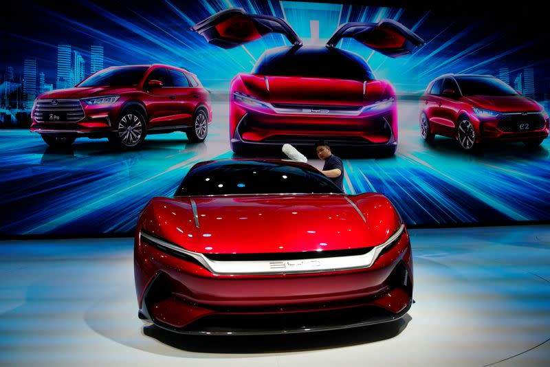 FILE PHOTO: Man cleans a BYD e-SEED GT concept EV during the media day for the Shanghai auto show in Shanghai