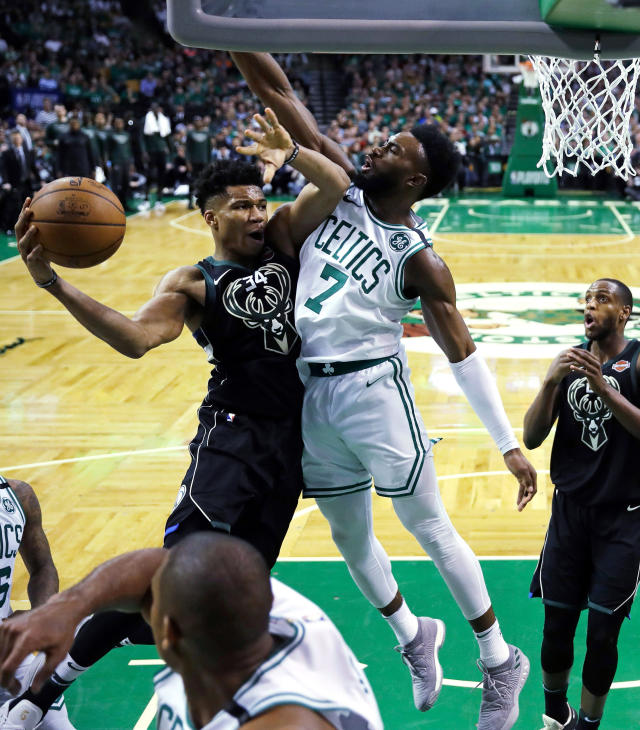 Boston Celtics guard Jaylen Brown (7) pressures Milwaukee Bucks forward Giannis Antetokounmpo, left, who looks to pass the ball during the second half of Game 5 of an NBA basketball first-round playoff series in Boston, Tuesday, April 24, 2018. The Celtics won 92-87. (AP Photo/Charles Krupa)