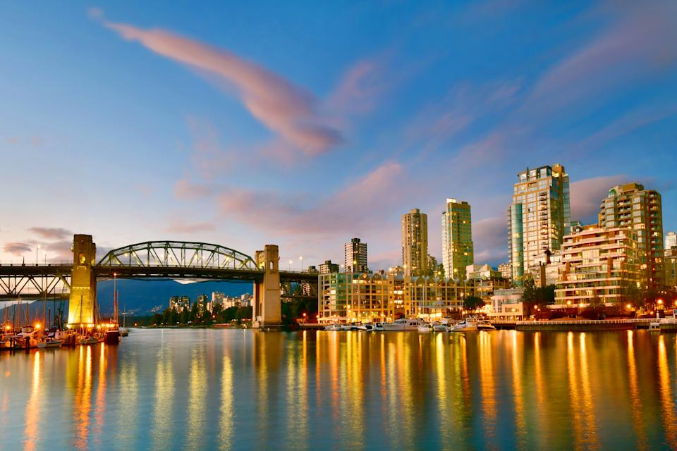 Beautiful view of Vancouver BC with harbor at sunset, Canada