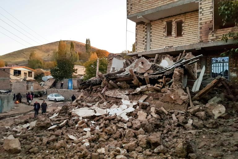 A pile of rubble is all that is left of one building in the village of Varnakesh after the pre-dawn quake which rocked northwestern Iran (AFP Photo/Mohammad ZEINALI)