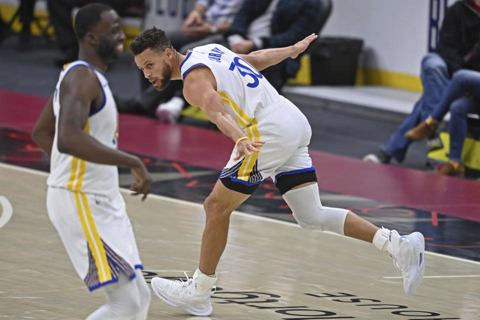 Golden State Warriors' Stephen Curry (30) celebrates after a three-point basket in the second half of an NBA basketball game against the Cleveland Cavaliers, Thursday, April 15, 2021, in Cleveland. (AP Photo/David Dermer)