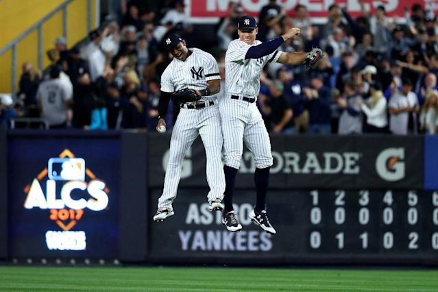 Aaron Hicks and Aaron Judge of the New York Yankees celebrate after beating the Houston Astros in Game 5 of the ALCS on Oc. 18, 2017 (Getty)