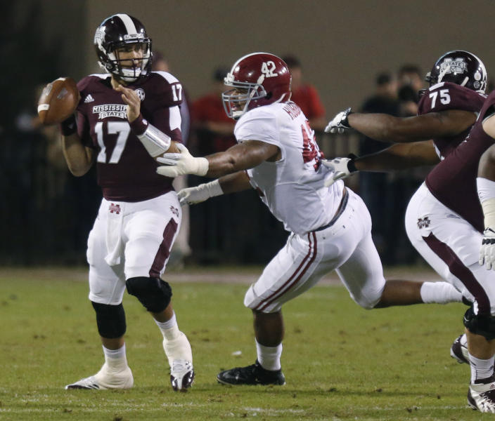 Mississippi State quarterback Tyler Russell (17) looks for an open receiver as Alabama linebacker Adrian Hubbard (42) closes in during the first half of an NCAA college football game, Saturday, Nov. 16, 2013, in Starkville, Miss. (AP Photo/Rogelio Solis)