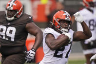 Cleveland Browns running back Kareem Hunt (27) rushes during an NFL football practice, Saturday, July 31, 2021, in Berea, Ohio. (AP Photo/Tony Dejak)