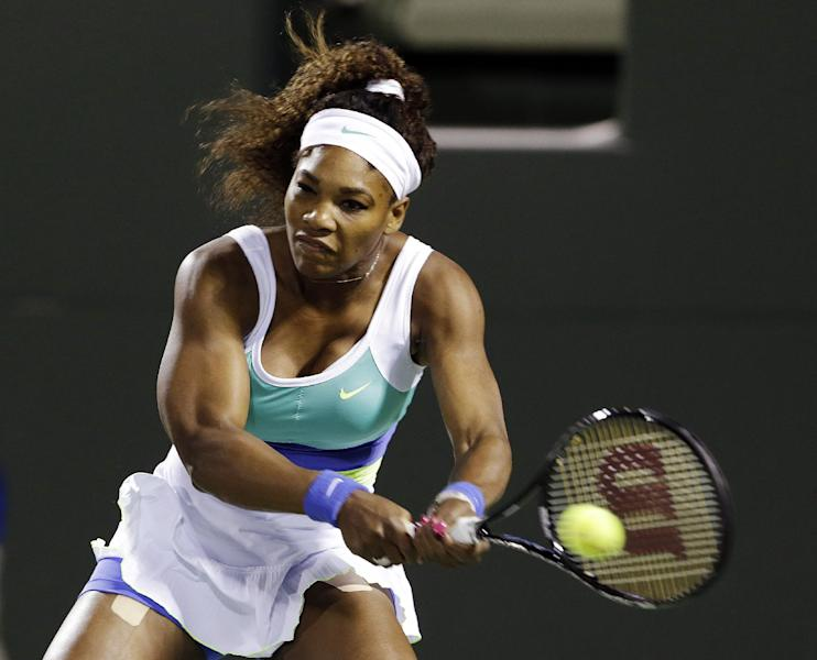 Serena Williams returns a shot from Agnieszka Radwanska, of Poland, during a semifinal match in the Sony Open tennis tournament, Thursday, March 28, 2013, in Key Biscayne, Fla. (AP Photo/Wilfredo Lee)