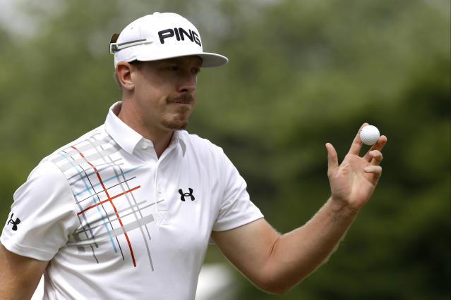 Hunter Mahan reacts after a putt on the first hole during the fourth round of the U.S. Open golf tournament at Merion Golf Club, Sunday, June 16, 2013, in Ardmore, Pa. (AP Photo/Morry Gash)