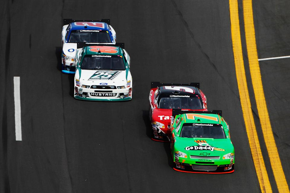 DAYTONA BEACH, FL - FEBRUARY 25: Danica Patrick, driver of the #7 GoDaddy.com Chevrolet, is pushed by teammate Dale Earnhardt Jr., driver of the #5 TaxSlayer.com Chevrolet, as Trevor Bayne, driver of the #60 Roush Fenway Racing Ford, is pushed by Elliott Sadler, driver of the #2 OneMain Financial Chevrolet, during the NASCAR Nationwide Series DRIVE4COPD 300 at Daytona International Speedway on February 25, 2012 in Daytona Beach, Florida. (Photo by Tom Pennington/Getty Images for NASCAR)
