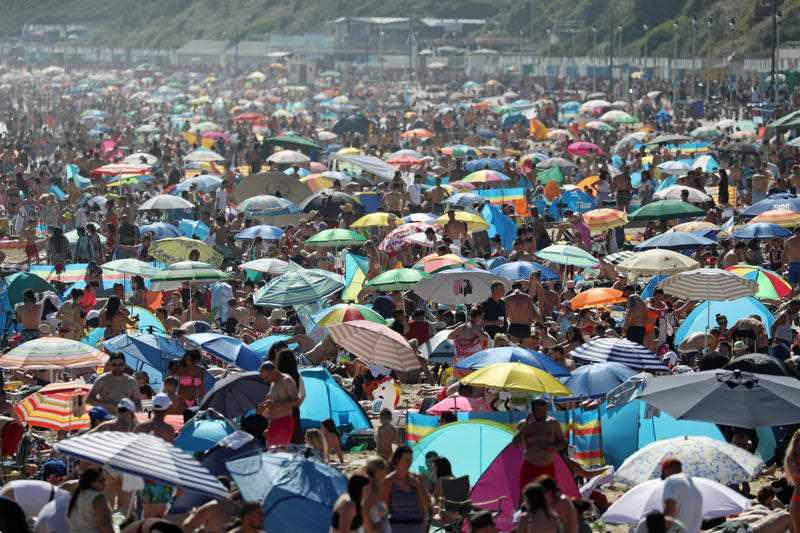 The scene on the beach in Bournemouth, Dorset, after the UK officially recorded its warmest day of the year so far.