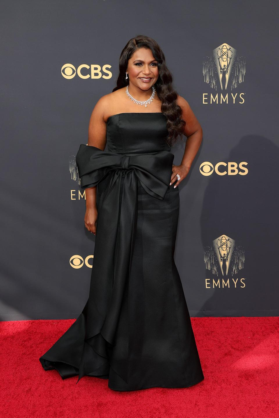 Mindy went for classic glam in a strapless black Carolina Herrera gown with a big bow belt.