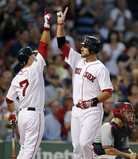 Atlanta Braves' David Ross, right, looks to the field as Boston Red Sox's Will Middlebrooks, center, celebrates his solo home run with Cody Ross (7) in the third inning of a baseball game in Boston, Saturday, June 23, 2012. (AP Photo/Michael Dwyer)