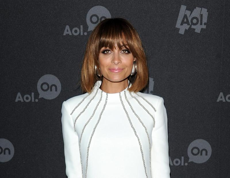 "FILE - This April 30, 2013 file photo shows television personality Nicole Richie at AOL's web series NewFront to promote her series ""#CandidlyNicole""  in New York. The first webisode, where 31-year-old Richie consults with a doctor about having her ""tramp stamp"" (or tattoo on her lower back) removed, earned 1 million views in just its first week.  (Photo by Evan Agostini/Invision/AP, file)"