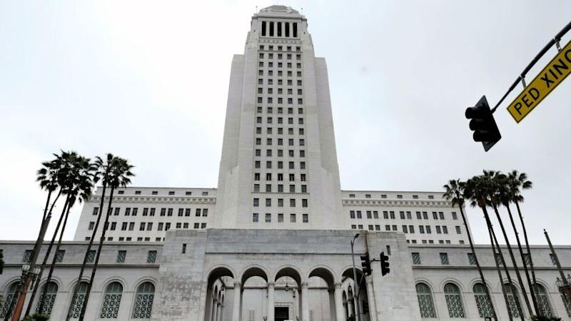 The Los Angeles City Ethics Commission has fined lobbyist John Ek $11,000 for inviting city officials to a birthday party at a downtown restaurant.