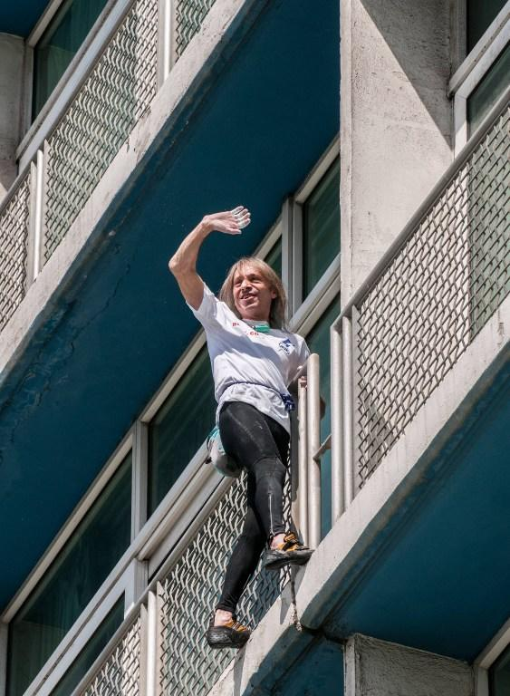 Daredevil French climber Alain Robert, known as the French Spiderman, waves while climbing the Habana Libre hotel, on February 4, 2013, in Havana. Robert climbed the 22 floors (around 70 meters) of the hotel in 28 minutes. Robert has climbed more than 100 of the world's tallest buildings, including the 828-metre Burj Khalifa in Dubai, Petronas Twin Towers in Kuala Lumpur, Sears Tower in the US city of Chicago and the 88-storey Jin Mao Building in Shanghai, China. AFP PHOTO