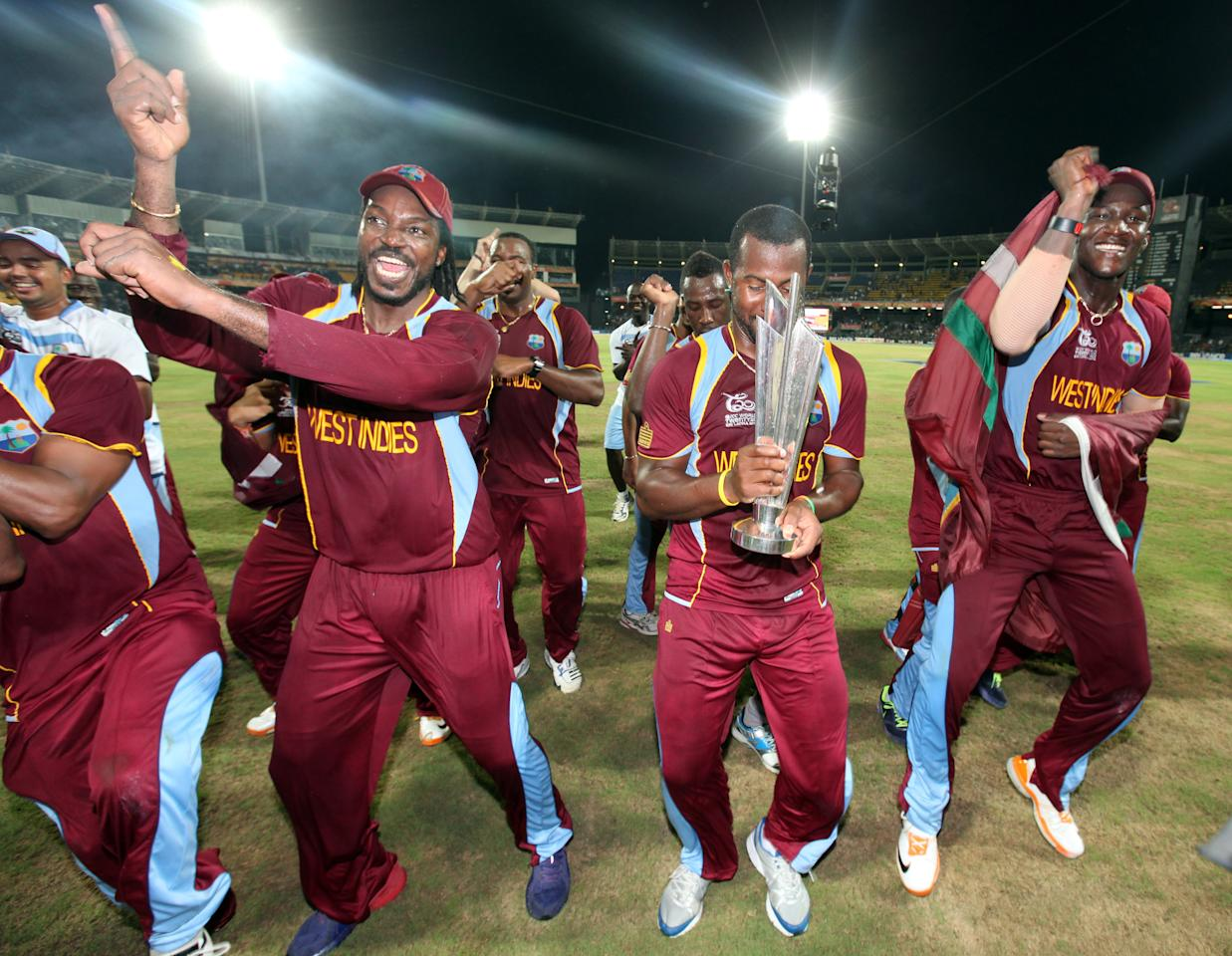 COLOMBO ,SRI LANKA - OCTOBER 7:  Chris Gayle, Johnson Charles and Darren Sammy of  West Indies celebrate after defeating Sri Lanka in the ICC  World Twenty20 2012 Final between Sri Lanka and West Indies at R. Premadasa Stadium on October 7, 2012 in Colombo, Sri Lanka.(Photo by Graham Crouch-ICC/ICC via Getty Images)