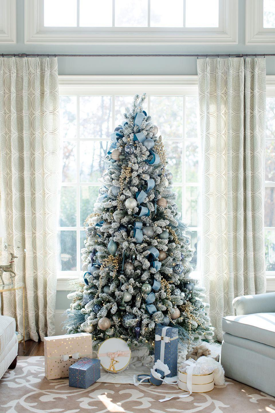 "<p>Whether you are looking for the perfect tree to match your <a href=""https://www.elledecor.com/design-decorate/room-ideas/g10302655/coastal-decor/"" rel=""nofollow noopener"" target=""_blank"" data-ylk=""slk:coastal decor"" class=""link rapid-noclick-resp"">coastal decor</a> or just prefer an unexpected holiday color scheme, a blue Christmas tree is always a beautiful choice. Kelly Page of <a href=""http://www.bluegraygal.com/blue-christmas-decorating-ideas/"" rel=""nofollow noopener"" target=""_blank"" data-ylk=""slk:bluegraygal"" class=""link rapid-noclick-resp"">bluegraygal</a> used blue and silver glass ornaments and gold garland to tie this tree into her existing decor. </p>"