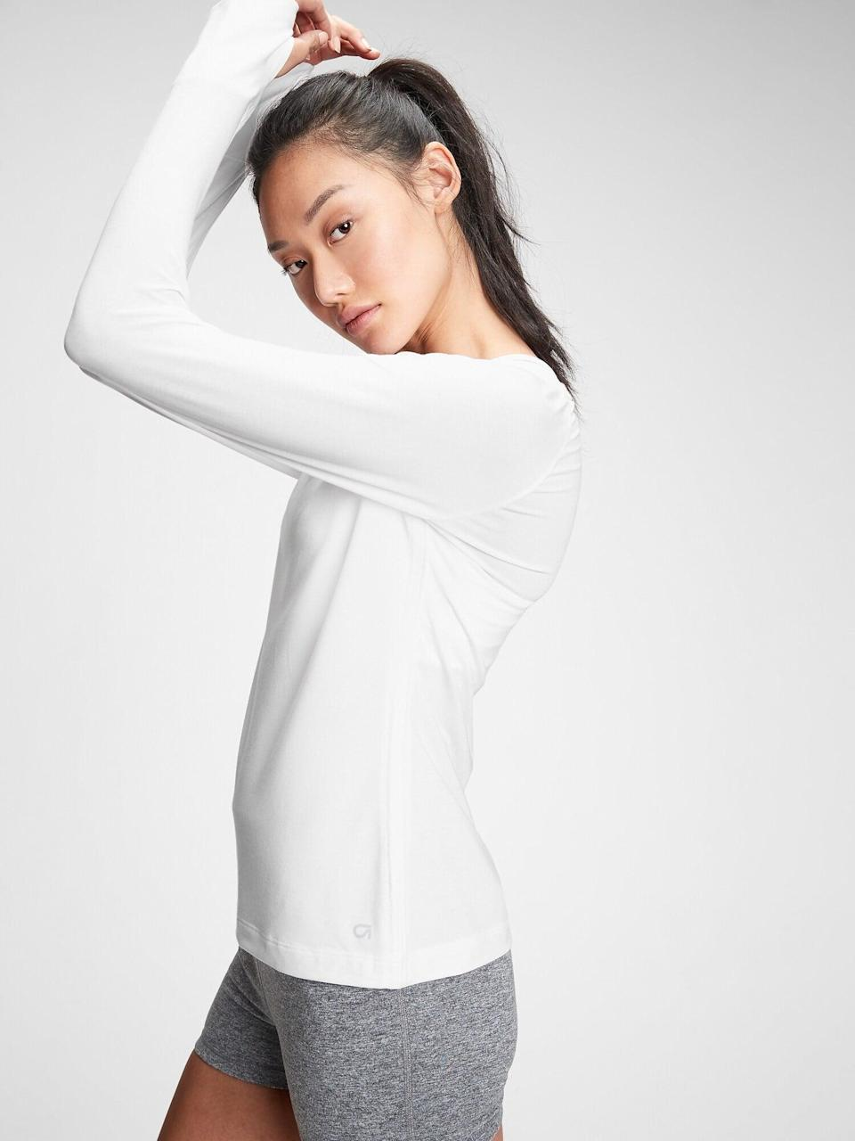 <p>Monica Lodwig, a Club Pilates instructor in San Clemente, CA, loves this <span>GapFit Breathe Boatneck T-Shirt</span> ($26, originally $35), because the lightweight performance jersey knit helps keep you cool. Plus, it has thumb holes to help keep the sleeves in place.</p>