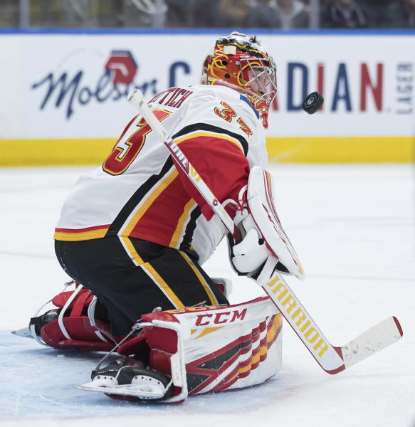 Calgary Flames goalie David Rittich, of the Czech Republic, makes a save against the Edmonton Oilers during the second period of an NHL hockey game Friday, Dec. 27, 2019, in Edmonton, Alberta. (Darryl Dyck/The Canadian Press via AP)